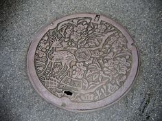 drain and manhole covers in Japan are decorated; cool!!