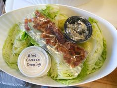Iceberg wedge with blue cheese dressing, bacon & blue cheese crumbles