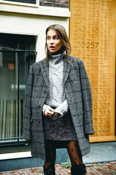 Lizzy shows us an incredibly chic way to wear a skirt for winter and we're taking notes! Pair your skirt with a wool coat, chunky cable knit turtleneck sweater, and don't forget a pair of tights. For maximum warmth, try with a pair of over-the-knee boots.