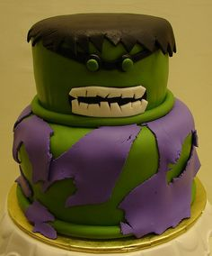 Incredible Hulk Birthday Cake. Two Tired Butter Yellow with buttercream and an outer layer of fresh fondant. All of the detail work if created out of fondant including his jagged hair and teeth, slanted brow and eyes, torn clothing and rolled finish  Amazing Picture! Have a look at this Incredible hulk hand image we found here - http://www.whoodie.com/squeeze-me-ts-c-58.html  #incrediblehulk