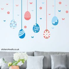 Make your Easter Sunday Special with this set of Easter egg wall stickers! This bright and beautiful Easter fabric wall sticker features with 6 different egg designs and comes with matching butterflies and flowers. Everything you need to create an inspiring and original Easter display.  If you are looking for an Easter theme for your office, home or child's room, these Easter wall decorations are really easy to put up, and can be moved around if required. Designed and hand finished in the…