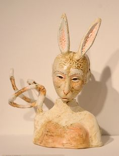 Lisa Clague Lisa Clague 1999 My work evokes a place between the subconscious and the intangible. My masked figures are hybrid creatu. Clay People, Art Forms, Lisa, Art Pieces, Sculpture, Christmas Ornaments, Holiday Decor, Artworks, Christmas Jewelry