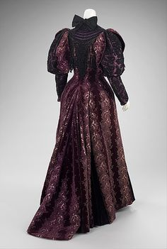 fashioninhistory: Ensemble House of Worth 1894 This extraordinary costume would have been worn while riding in one's carriage, which at the time was a social event. It is likely the muff and mantle were bought from the House of Worth but due to the 1890s Fashion, Edwardian Fashion, Vintage Fashion, Antique Clothing, Historical Clothing, Vintage Gowns, Vintage Outfits, Charles Frederick Worth, House Of Worth