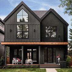 Delightful dark modern two story farmhouse with just a hint of contrast in the cedar beam. Large black windows and dutch doors bring the outdoors indoor and create an inviting family home. House by Trickle Creek Custom Homes. Black Windows Exterior, Black House Exterior, Exterior House Colors, Exterior Design, Exterior Homes, Exterior Paint, Dark House, Modern Farmhouse Exterior, Pole Barn Homes