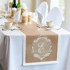Bring the charm and comfort of a warm afternoon countryside to your wedding day decor with our Country Chic Decorative Table Runners. Fitted with a picturesque print of outdoorsy burlap and featuring a scrolling personalized crest, this unique table runner is idyllic for decorating cake, gift, guest or head tables.Because each custom runner is fashioned in crisp cotton and printed exclusively for every bride and groom, it's an ideal canvas for the do-it-yourself fun to really stand...