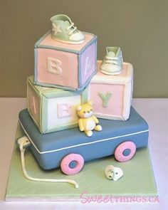 Very sweet baby shower cake. i love how the baby blocks to gos so perfectly with the baby shower theme.