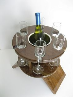 Compact design wine table for limousines or sedans that is 13 inches in diameter. Holds 6 flute glasses.