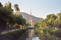 About an hour's drive outside Rio, up in the mountains.  Petropolis is a lovely mountain village near Rio with acccessible history, friendly people and good food. A nice respite from the noise and bustle of Rio.