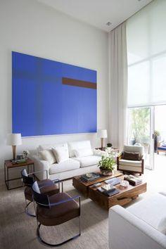azulão com sofá branco