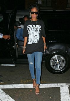 Rihanna wearing Gianni Versace Vintage Medusa Bracelet, Roberto Cavalli Spring 2013 Sandals, Frank151 Chapter 51 Leader's Tee in Black, J Brand 620 Mid-Rise Super Skinny Jeans in Revenge and Le Specs Bowie Sunglasses.