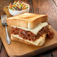 BBQ Pulled Pork Grilled Cheese! Grilled cheese becomes a satisfying supper when it is stuffed with BBQ pork.