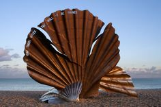 "The Scallop by Maggi Hambling is a sculpture dedicated to Benjamin Britten on the beach at Aldeburgh. The edge of the shell is pierced with the words ""I hear those voices that will not be drowned"" from Peter Grimes."