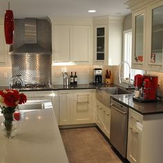 Glass Subway Tile, dark countertops, white cabinets