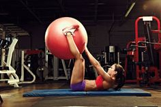Keep your six-pack intact throughout the holiday season with this challenging core-centric medicine ball workout, demonstrated by IFBB bikini pro Kelsie Burgin
