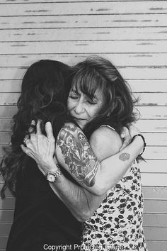LOUD LOVE PHOTOGRAPHY #candid #Family #Love #mother #Daughter #special #tattoos #tats #fashion #portrait #diadelosmuertos #skull #skills #emotional #hug #embrace #loudlovephotography #sandiego #photography #losangeles #socal #blackandwhite #longhair #waves #curls