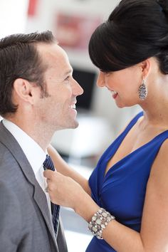 Mad Men inspired couple caught in a romantic moment during their engagement shoot. Photo by Michael L'Heureux via JunebugWeddings.com.