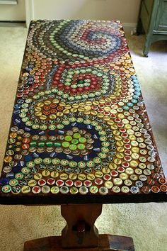 Start saving your bottle caps and use them to cover a plain coffee table or even surface a bar top