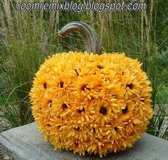pumpkin has been covered with artificial flowers...You could do this with real flowers too!