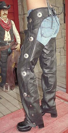 Jamin' Leather Exclusive cowhide western chaps with conchos. Features zipper wind flap, rawhide lacing, cell phone pocket, pen pocket and braided leather trim. Unisex styling. #C011CC