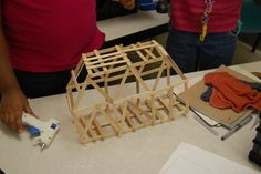 The popsicle stick bridge, a classic kid's engineering project.