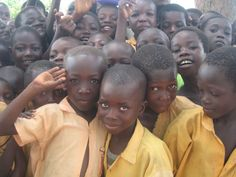 Schoolchildren in Ghana pose for the camera. This looks so familiar