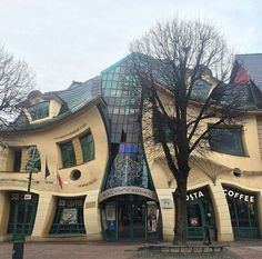 "Krzywy Domek ""Crooked House"", Poland. The Krzywy Domek is an unusual piece of architecture located on Monte Cassino Street in Sopot. Completed in 2004, the building was designed by Szotyńscy and Zaleski who were inspired by the fairytale illustrations and drawings of Jan Marcin Szancer and Per Dahlberg as well as designs by Antonio Gaudi."