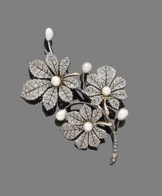 A late 19th century pearl and diamond spray brooch, by Mellerio dits Meller Of foliate design, the detachable leaves set with rose-cut diamonds and highlighted with 5.0mm-6.5mm baroque pearls, mounted in silver and gold