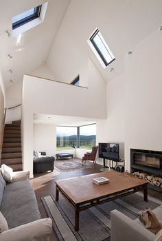 Gabled stone and glass Torispardon home reinterprets Scottish farm structures | Architecture