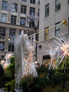 A Christmas angel in Rockefeller Center, with the snowflakes on the front of the Saks Fifth Avenue building in the background Copyright: Ria Mitchell