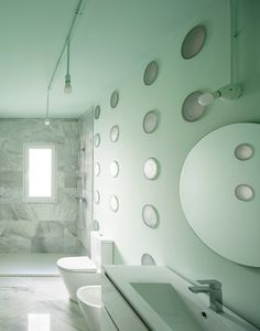 GRX Arquitectos designed The House of Curtains to bring brightness back into the dimly lit apartment of a psychologist in Granada, Spain. Bathroom Interior Design, Interior Walls, Floor To Ceiling Curtains, Concrete Interiors, Curved Walls, Mint, Cool Tones, Skylight, Elle Decor