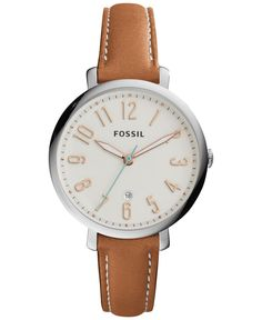 Casually chic, this leather strap watch from the Jacqueline collection by Fossil features a soft cream dial with an aqua colored second hand for a fun pop of color. | Tan leather strap | Round stainle