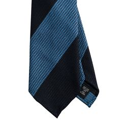 Exquisite Trimmings | Accessories | Ties | EXCLUSIVE Navy Blue Block Stripe 7Fold Tie Your Tie was founded as a small shop in Florence, Italy in 1984. The tradition of the brand has catered for a uniquely individual, yet wonderfully classic taste. The shop presents classic items chosen with love and affection after the style of Franco Minucci. It is like a personal wardrobe and has become a must-visit destination for stylish gentlemen. Tie Your Tie creates items that are unique and of the…