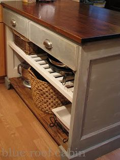 Kitchen island built from a door - diy-I could do this with a dresser. I'd just take the drawers out and paint the inside.