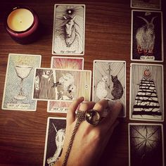 sugarhighlovestoned: Rainy day tarot readings with my new favorite deck by @the_wild_unknown ☽☯♱❍☥☮☾