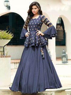 Enthralling blue embroidered gown online at best shopping price. Shop this latest gown style for diwali celebration. This alluring style set comprises a silk gown with matching crepe bottom.