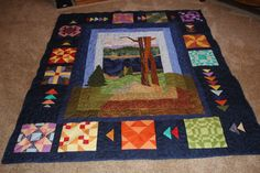 a block of the month- the lake scene is all individual fabrics- my first attempt at machine applique
