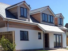 Developments Limited – building the highest quality homes in the Southwest. – New Build Dormer Bungalow Wood Cladding Exterior, Cedar Cladding, House Cladding, Facade House, Cladding Design, Dormer House, Dormer Bungalow, Dormer Windows, Grey Windows