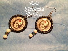 Bottle cap skeleton cameo earrings with faux pearl accents on Etsy, $6.00 CAD