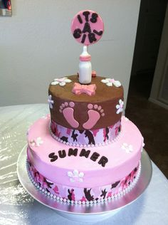 Brown & pink baby shower cake with camo ribbon & footprints.