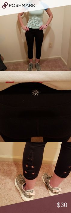 Athleta Cropped Leggings - Sz Medium Cute in excellent condition black leggings with little bow cut outs at the bottom of leg. Athleta Pants Leggings