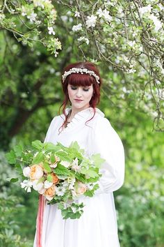 Natural organic wedding inspiration with a romantic spring bouquet, touches of copper and vintage wedding dresses