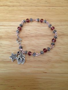 Hand crafted Swarovski bracelet with flip flop and starfish charm
