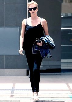 Charlize Theron is casually chic in a tank and cropped jeans #dailymail