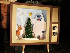 One of the most amazing Christmas decorating ideas... ever. Ashley and Greg Brown of 7th House on the Left recreated a scene from the classic Christmas TV special Rudolph the Red Nosed Reindeer in a giant 1960s TV. See Bumble, the snow monster? He's 5 feet tall! | @7thhouse