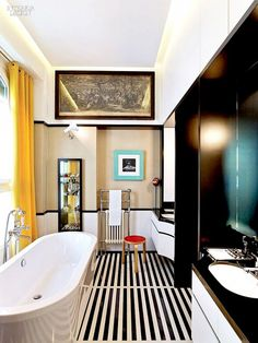 Black and white striped floor in bathroom and yellow curtains