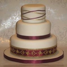 Burgandy & Ivory Wedding Cake--but instead of Burgandy, lets go with royal blue.