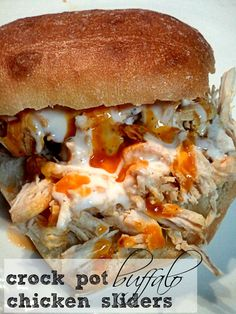 Man bites: Buffalo Chicken Sliders ... In the Crock Pot! Something my picky husband would love to eat!