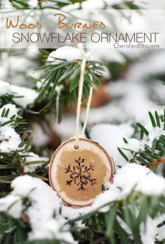 To create this rustic ornament, paint a wood slice gold, then use a wood burner to draw a pretty snowflake.