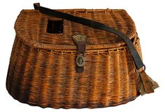 Antique fishing creel with tightly woven willow found in England. Detailed with leather and canvas strap, brass hardware and lid with opening for fish.