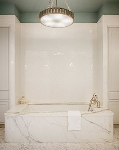 Beautiful Marble Surround; Drop In Tub. Ceiling detail.